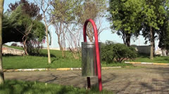 Metal bin in park 2 - stock footage
