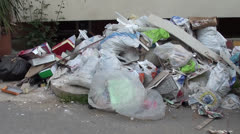 Rubbish dump on the street Stock Footage