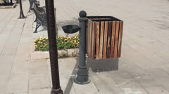 Trash can on the street - stock footage