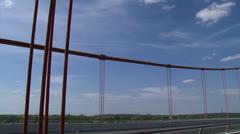 Suspender cables + pan pillars suspension bridge Stock Footage
