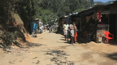 India Western Ghats ramshackle booths on dirt road 2 Stock Footage