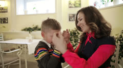 Mom comforts his son, who was crying - stock footage