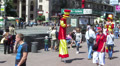 Clowns on stilts. Editorial. Footage