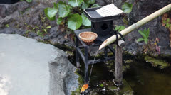 Japanese fountain in on of the Hasedera shrine of Kamakura city, Japan Stock Footage