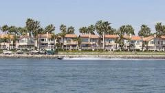 Jet Ski Right to Left Waterfront Houses and Boats - stock footage