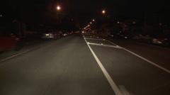 Driving POV night wide suburban road Stock Footage