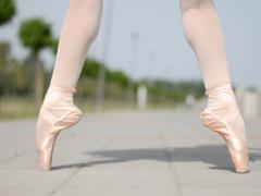 Ballerina dancing on tiptoe in ballet shoes - stock footage