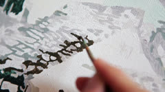 Drawing a picture with a brush and paints close-up Stock Footage