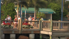 Themepark Visitors Arriving at the Entrance to Seaworld Orlando Stock Footage