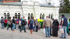 Visitors to Holy Trinity St. Sergius Lavra near trade points, Sergiev Posad Stock Footage