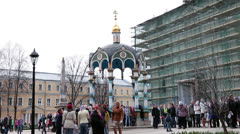 Sacred fountain with people taking water. Russia Stock Footage