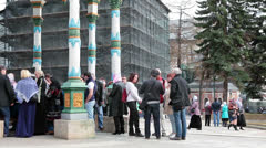 People collect water from a sacred source. Sergiev Posad, Russia Stock Footage
