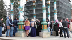 Visitors collect water from a sacred source. Sergiev Posad, Russia Stock Footage
