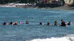 Bali-Tulamben scuba divers group start Stock Footage