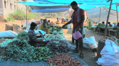 India man shopping in a village market Stock Footage