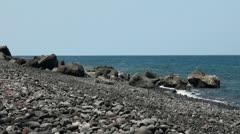 Bali-Tulamben dive location stoney beach Stock Footage