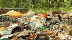 Garbage dump in the woods. Environmental contamination Stock Footage