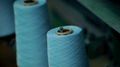 Thread unwinds from the spool Stock Footage