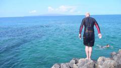Older Man Diving in Ocean - stock footage