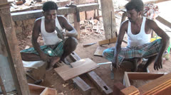 India Tamil Nadu Chettinad woodworkers seated in frame of house 2 Stock Footage