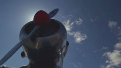 Fighter Plane Nose Sunflare Reveal low angle dolly Stock Footage
