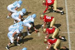 Football Players on the Line of Scrimmage #2 Stock Photos