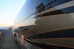 Luxury Tour Bus in Sunset - stock photo