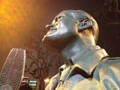 Nighttime close up of Bob Hope Statue on San Diego Bay - stock photo