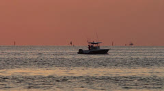 A fishing boat heads out into the Gulf Stream at daybreak in the Florida Keys. Stock Footage