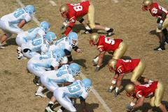 Football Players on the Line of Scrimmage - stock photo