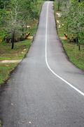 paved highway decline and uphill - stock photo