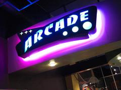 Arcade Sign with Neon Lights Stock Photos