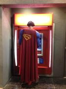 Superman at the ATM - stock photo