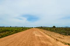 a direct road in the plains - stock photo