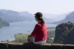 Mature woman viewing the columbia river gorge from high above Stock Photos