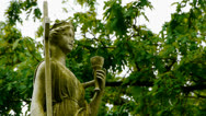 Stock Video Footage of Statue with Chalice and Cross