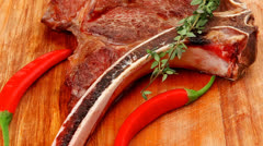 Meat food : grilled beef spare rib on wooden plate Stock Footage