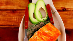 Hot baked salmon piece served with vegetables Stock Footage