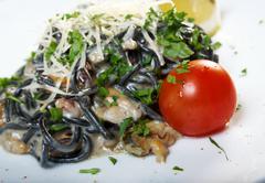 spaghetti al nero di seppia - stock photo