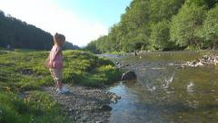 Child Playing at Mountain River, Girl Throwing Stones in Stream Water, Children - stock footage