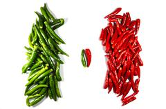 opposition of two heaps of chili papers - stock photo