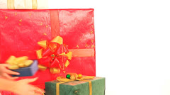 Нand put group of colour gift box. Stock Footage