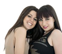 Two beautiful young sensual glamour women standing together over white backgr Stock Photos