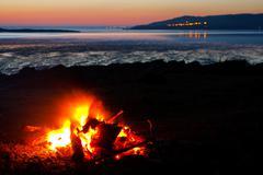 roaring bonfire at the beach - stock photo