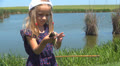 Child Kissing a Caught Fish, Little Girl Playing on a Fishing Lake, Children HD Footage