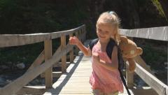 Child Running on a Bridge over a Mountain River, Tourist in a Trip, Children Stock Footage