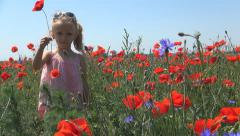 Smiling Child Playing with Poppy Flower on Field, Girl on a Meadow, Children Stock Footage