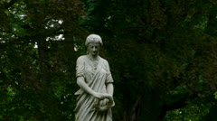 Cemetery Statue on Windy Day Stock Footage