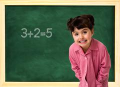 School child and board Stock Photos