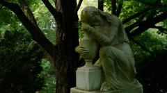Statue of Mourning Woman - stock photo